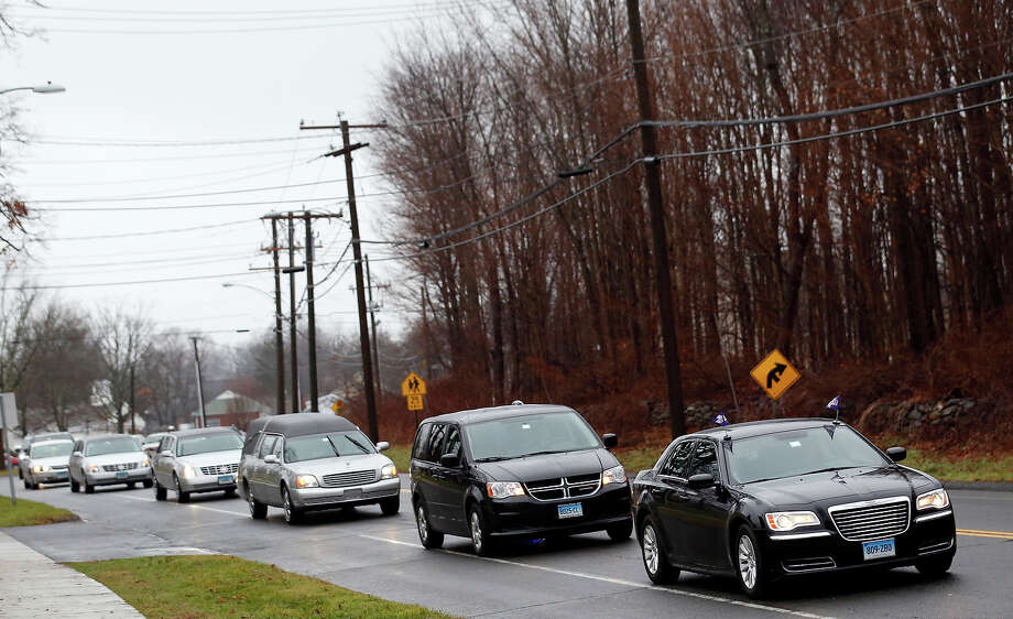 A procession leads a hearse toward St. Rose of Lima Roman Catholic Church during funeral services for James Mattioli, Tuesday, Dec. 18, 2012, in Newtown, Conn. Mattioli, 6, was killed when Adam Lanza walked into Sandy Hook Elementary School in Newtown, Conn., Dec. 14,  and opened fire, killing 26 people, including 20 children, before killing himself. Photo: AP