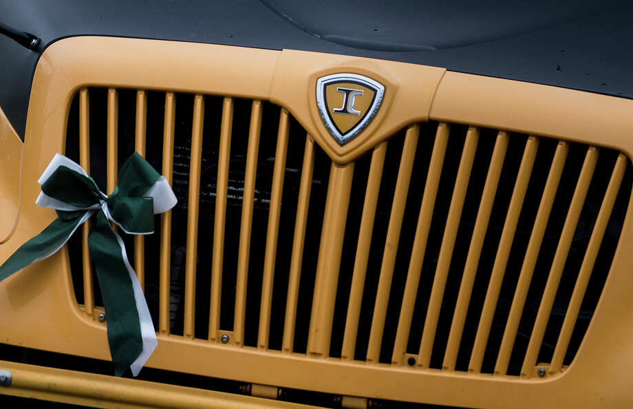 A school bus grill is decorated with the school colors, green and white, of Sandy Hook Elementary School December 18, 2012 in Newtown, Connecticut. Students in Newtown, excluding Sandy Hook Elementary School, return to school for the first time since last Friday's shooting at Sandy Hook which took the live of 20 students and 6 adults.  AFP PHOTO/Brendan SMIALOWSKI Photo: BRENDAN SMIALOWSKI, AFP/Getty Images / 2012 AFP