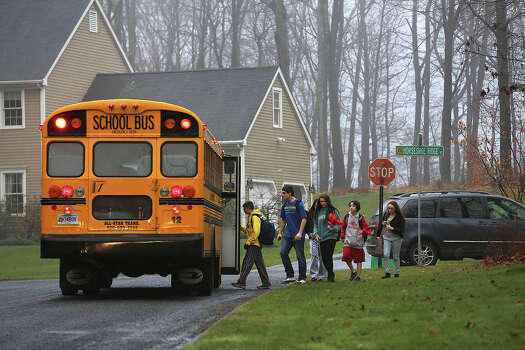 NEWTOWN, CT - DECEMBER 18:  Children return to school on December 18, 2012 in Newtown, Connecticut. Four days after 20 children and six adults were killed at Sandy Hook Elementary School, most students in Newtown returned to school. Children at Sandy Hook Elementary will attend a school in a neighboring town until authorities decide whether or not to reopen Sandy Hook. Photo: John Moore, Getty Images / 2012 Getty Images