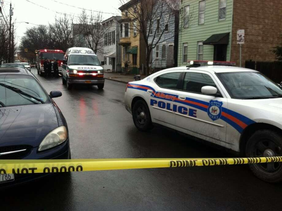 Police closed off a section of Ontario Street in Albany on Tuesday morning after finding a man in the backyard of 55 Ontario St. (Skip Dickstein/Times Union)