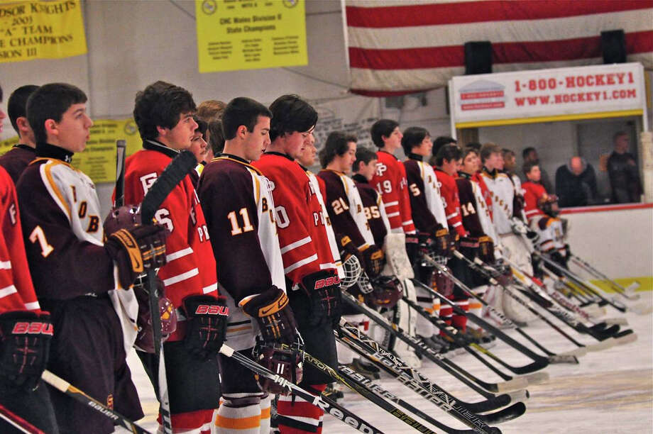 Fairfield Prep and South Windsor High School's hockey teams show solidarity during a moment of silence for Sandy Hook Elementary School victims on Saturday in South Windsor. Photo: Contributed Photo