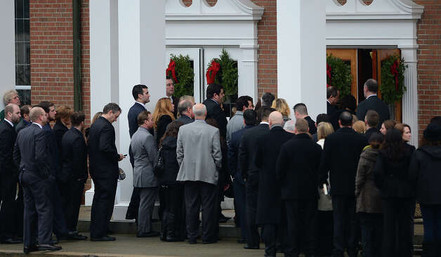 Mourners arrive for the funeral of Jessica Rekos, 6  at  Saint Rose of Lima Church  on December 18, 2012 in Newtown, Connecticut for her funeral. Most children in Newtown returned to classes Tuesday for the first time since last week's massacre, but survivors of the shooting stayed at home and their school remained a crime scene. In a thin drizzle, yellow school buses once again rolled through the Connecticut town, where some 5,400 children are enrolled. AFP PHOTO/EMMANUEL DUNAND Photo: EMMANUEL DUNAND, AFP/Getty Images / 2012 AFP