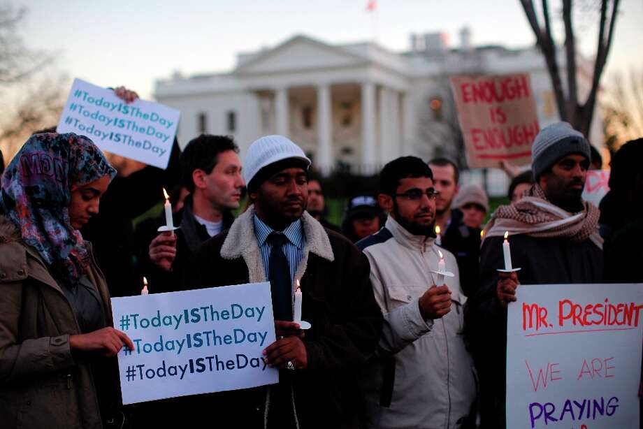 Supporters of gun control gather on Pennsylvania Avenue in front of the White House in Washington, Friday, Dec. 14, 2012, during a vigil for the victims of the shooting at Sandy Hook Elementary School in Newtown, Ct., and to call on President Obama to pass strong gun control laws. Photo: Charles Dharapak, AP / 2012 AP