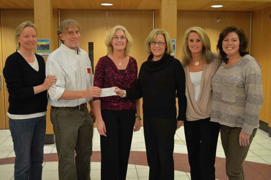 With their check for $6,500 to the New Canaan High School Scholarship Foundation are, from left, Kathy Schulte, NCHS Scholarship Drive co-chairman; Cam Hutchins, NCHS '77 Reunion Committee Scholarship Fund chairman; Erin Babrowicz, NCHS í77 Reunion Committee co-chairman; Therese Chaisson, Scholarship Foundation administrative director; and Lisa Isherwood and Mary DiCosmo, NCHS Scholarship Drive co-chairmen. Photo: Contributed