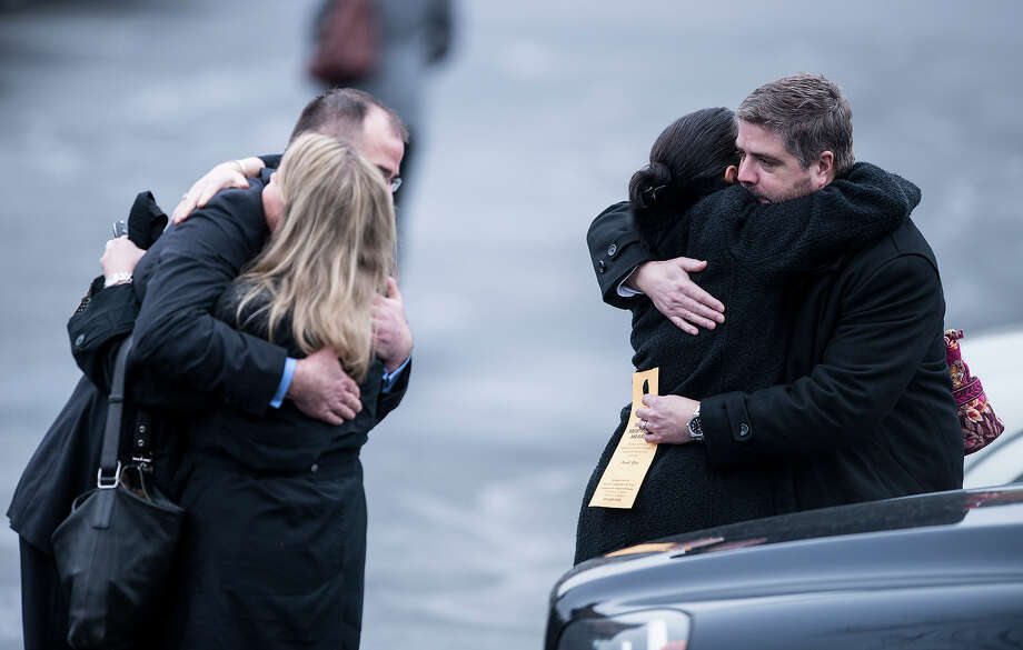 People console each other after the funeral mass for James Mattioli at St. Rose of Lima Roman Catholic Church on December 18, 2012 in Newtown, Connecticut. Mattioli, age 6, is one of the victims from last Friday's shooting at Sandy Hook Elementary School which took the lives of 20 students and 6 adults.    AFP PHOTO/Brendan SMIALOWSKI Photo: BRENDAN SMIALOWSKI, AFP/Getty Images / 2012 AFP