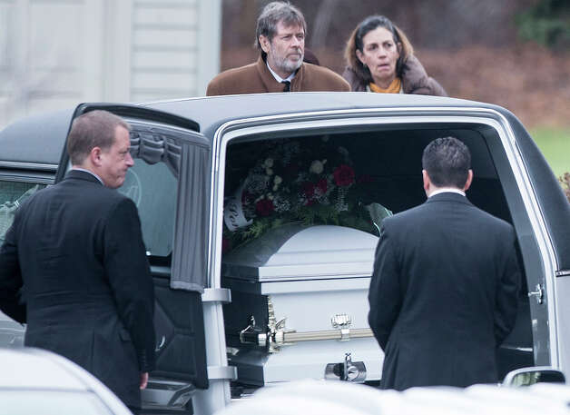 A man looks at the casket of James Mattioli outside St. Rose of Lima Roman Catholic Church after a funeral Mass on December 18, 2012 in Newtown, Connecticut. Mattioli, 6, is one of the victims from last Friday's shooting at Sandy Hook Elementary School which took the lives of 20 students and 6 adults.  AFP PHOTO/Brendan SMIALOWSKI Photo: BRENDAN SMIALOWSKI, AFP/Getty Images / 2012 AFP