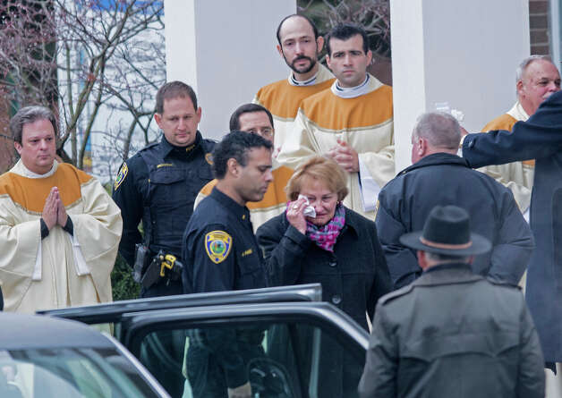 Loved ones leave after a funeral Mass for James Mattioli outside St. Rose of Lima Roman Catholic Church on December 18, 2012 in Newtown, Connecticut. Mattioli, 6, is one of the victims from last Friday's shooting at Sandy Hook Elementary School which took the lives of 20 students and 6 adults.  AFP PHOTO/Brendan SMIALOWSKI Photo: BRENDAN SMIALOWSKI, AFP/Getty Images / 2012 AFP