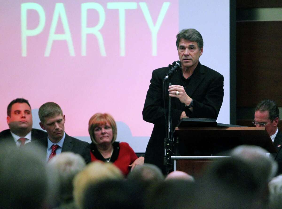Texas Gov. Rick Perry speaks during a Northeast Tarrant Tea Party gathering in North Richland Hills, Texas, on Monday, Dec. 17, 2012. (AP Photo/The Dallas Morning News, Mona Reeder)