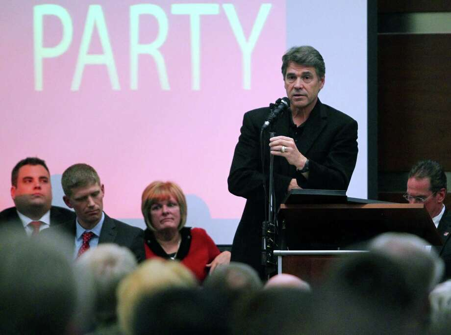 Texas Gov. Rick Perry speaks during a Northeast Tarrant Tea Party gathering in North Richland Hills, Texas, on Monday, Dec. 17, 2012. (AP Photo/The Dallas Morning News, Mona Reeder) Photo: Mona Reeder, Associated Press / The Dallas Morning News