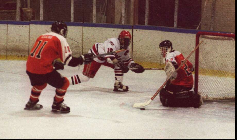 Stamford high school played New Canaan high school at the Darien rink on saturday evening.  Stamford goalie #23 Justin D'Agostino and #11 Mike Collins defend against New Canaan captain #16 Chip Buzzeo.   Feb 17, 96 Tom Ryan/Staff Photo Photo: ST