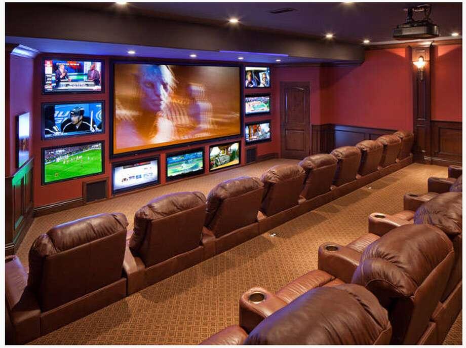 The La Jolla mansion has a multi-screen media room. (Sheldon Good & Co.)