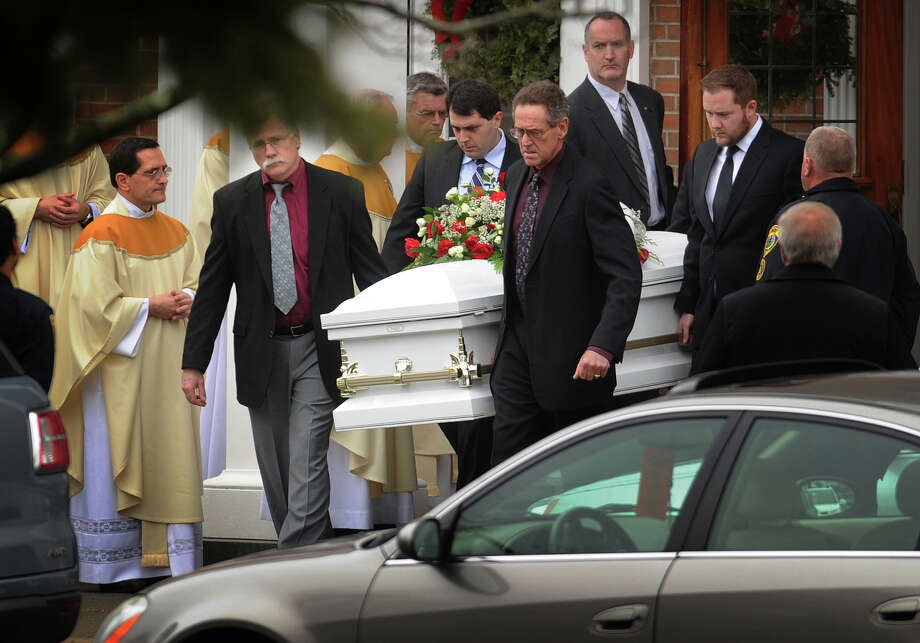 The casket of James Mattioli, one of the twenty students killed in the Sandy Hook Elementary School shootings, is carried from St. Rose of Lima Catholic Church in Newtown on Tuesday, December 18, 2012. Photo: Brian A. Pounds / Connecticut Post