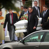 The casket of James Mattioli, one of the twenty students killed in the Sandy Hook Elementary School shootings, is carried from St. Rose of Lima Catholic Church in Newtown on Tuesday, December 18, 2012.