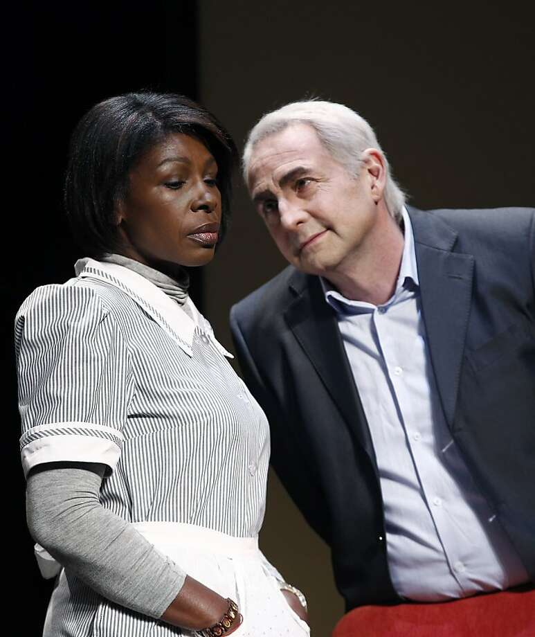 "Jelle Saminnadin as Nafissatou Diallo and Eric Debrosse as Dominique Strauss-Kahn in ""Suite 2806."" Photo: Christophe Ena, Associated Press"