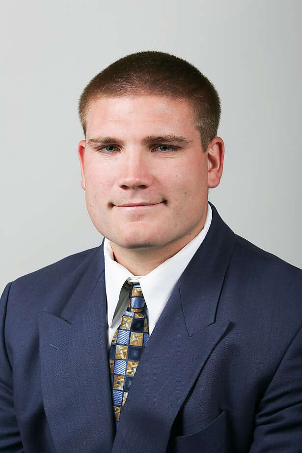 """8. Tosh Lupoi -- assistant UW football coach""""Fiery and energetic, he has a surprisingly tender face. Although it may be hard to find a picture of him smiling on the Web, something in his smirk suggests that dimples lurk beneath."""" Photo: Cal Football Headshots / Cal Football headshots"""