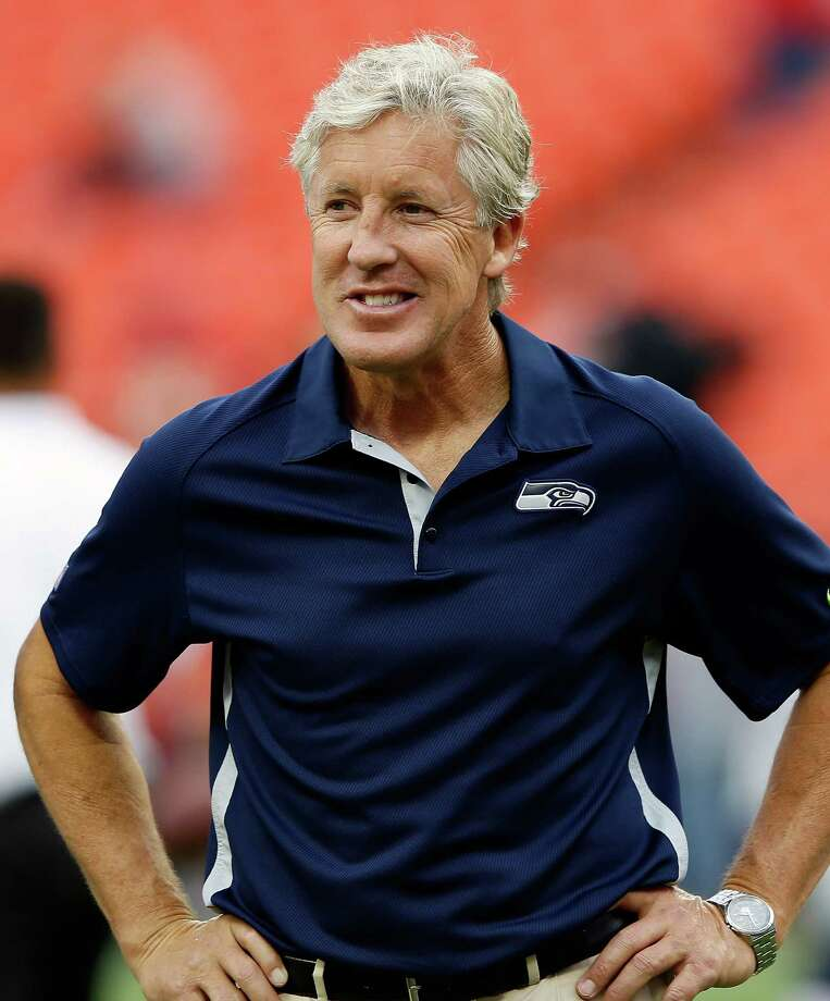 "10. Pete Carroll -- Seahawks head coachHow does a 61-year-old make this list? Female expert: ""This one kind of snuck up on me. Good hair, great smile, charisma galore. Then there's that crazy energy."" Photo: Jamie Squire, Getty Images / 2012 Getty Images"