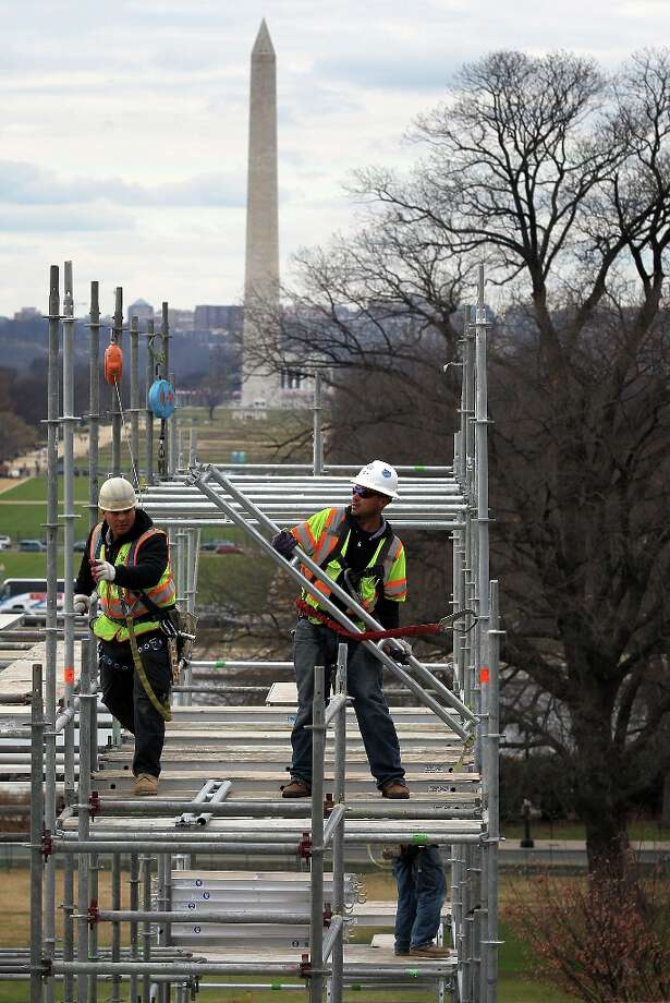 WASHINGTON, DC - DECEMBER 11:  Construction workers build the Inaugural platform December 11, 2012 on Capitol Hill in Washington, DC. President Barack Obama will be sworn in for his second term as the President of the United States during a private ceremony on January 20 and a public ceremony on January 21, 2013. Photo: Alex Wong, Getty Images / 2012 Getty Images