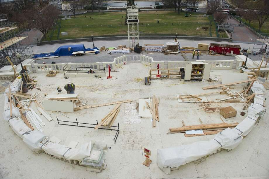 Construction continues as workers build the platform to be used for the Presidential Inauguration ceremony on the west front of the US Capitol in Washington, DC, as seen on December 11, 2012. US President Barack Obama's second inauguration will take place with a public ceremonial oath of office on January 21, 2013. Photo: SAUL LOEB, AFP/Getty Images / AFP