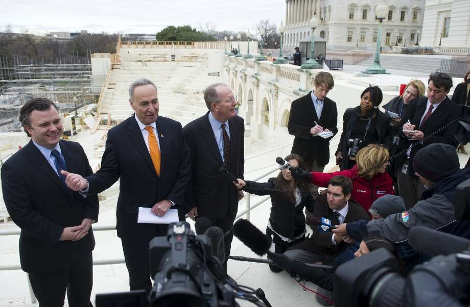 US Democratic Senator Chuck Schumer (2nd L) of New York and Republican Senator Lamar Alexander (C) of Tennessee speak during a press conference to discuss construction work on the platform to be used for the Presidential Inauguration ceremony on the west front of the US Capitol in Washington, DC, as seen on December 11, 2012. US President Barack Obama's second inauguration will take place with a public ceremonial oath of office on January 21, 2013. Photo: SAUL LOEB, AFP/Getty Images / AFP