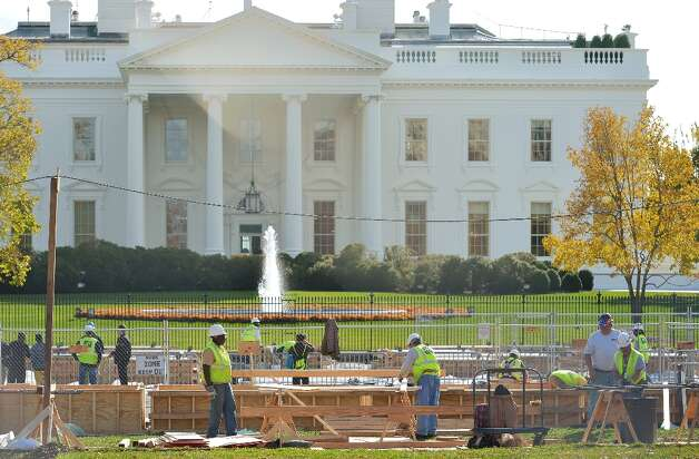 Workers are seen in front of the White House during preparation of a review stand for the presidential inauguration on November 12, 2012in Washington,DC. The Presidential Inauguration will take place on January 21, 2013. Photo: MANDEL NGAN, AFP/Getty Images / AFP