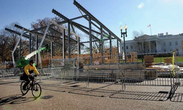 A police officer rides his bike in front of the White House on Pennsylvania Avenue during preparation of a review stand for the presidential inauguration on November 26, 2012 in Washington, DC. The presidential inauguration will take place on January 21, 2013. Photo: Olivier Douliery, McClatchy-Tribune News Service / Abaca Press