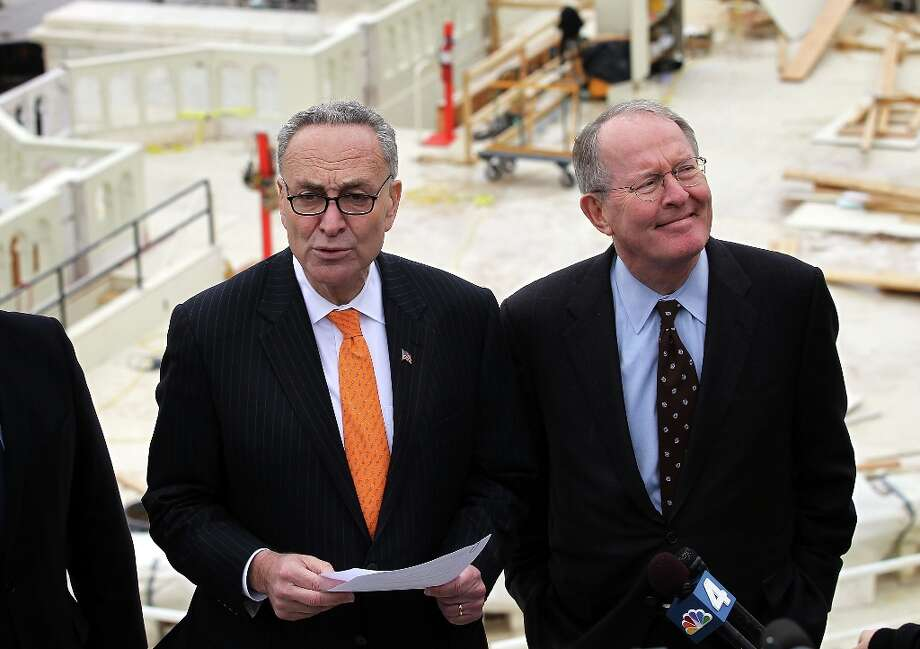 WASHINGTON, DC - DECEMBER 11:  Chairman and Vice Chairman of the Joint Congressional Committee on Inaugural Ceremonies, U.S. Senators Charles Schumer (D-NY) (L) and Lamar Alexander (R-TN) (R),  speak to members of the media during a tour of the Inaugural setup December 11, 2012 on Capitol Hill in Washington, DC. President Barack Obama will be sworn in for his second term as the President of the United States during a private ceremony on January 20 and a public ceremony on January 21, 2013. Photo: Alex Wong, Getty Images / 2012 Getty Images