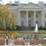 Workers are seen infront of the White House during preparation of a review stand for the presidential inauguration on November 12, 2012 in Washington,DC. The Presidential Inauguration will take place on January 21, 2013.