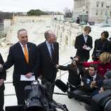 US Democratic Senator Chuck Schumer (2nd L) of New York and Republican Senator Lamar Alexander (C) of Tennessee speak during a press conference to discuss construction work on the platform to be used for the Presidential Inauguration ceremony on the west front of the US Capitol in Washington, DC, as seen on December 11, 2012. US President Barack Obama's second inauguration will take place with a public ceremonial oath of office on January 21, 2013.