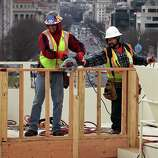 WASHINGTON, DC - DECEMBER 11:  Construction workers build the Inaugural platform December 11, 2012 on Capitol Hill in Washington, DC. President Barack Obama will be sworn in for his second term as the President of the United States during a private ceremony on January 20 and a public ceremony on January 21, 2013.