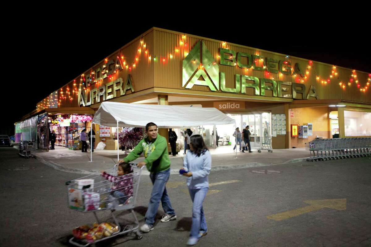 Shoppers outside Wal-Mart's Bodega Aurrera in Teotihuacan, Mexico, Nov. 18, 2011. An examination by The New York Times found that Wal-Mart de Mexico has been an aggressive and creative corrupter in Mexico, offering large payoffs to get what the law otherwise prohibited.