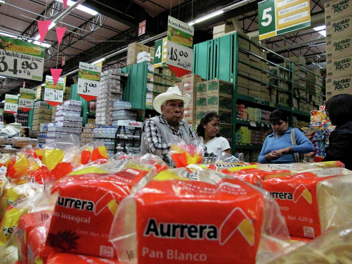 Shoppers at Wal-Mart's Bodega Aurrera in Teotihuacan, Mexico, Nov. 18, 2011. An examination by The New York Times found that Wal-Mart de Mexico has been an aggressive and creative corrupter in Mexico, offering large payoffs to get what the law otherwise prohibited.
