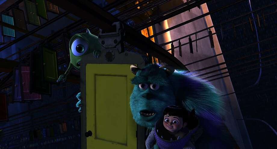 "Mike (Billy Crystal, left), Sulley (John Goodman) and Boo (Mary Gibbs) dart about in ""Monsters, Inc. 3D."" Photo: Disney Pixar"