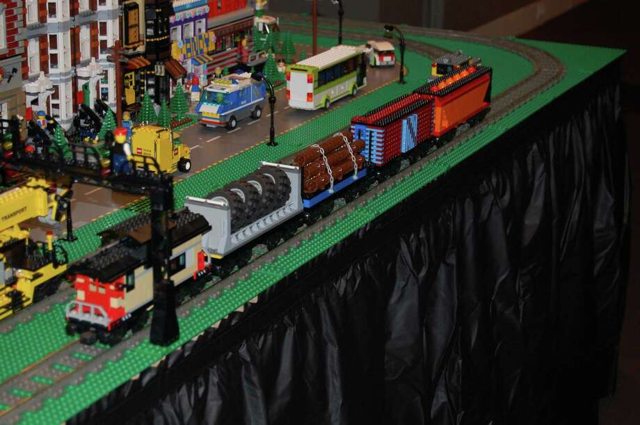 """All Aboard with Bill Probert & Friends III"" an exhibition that celebrates the creative possibilities of LEGO. Probert returns for his third year at the Stamford Museum and Nature Center in Stamford, Conn., to create unique landscapes and scenes, as well as moving trains, with help from members of I LUG (a LEGO users group) NY. The exhibition runs through Sunday, Jan. 27. There are a number of events planned for the final weekend before Christmas 2012. For more information, visit http://www.stamfordmuseum.org. Photo: Contributed Photo"