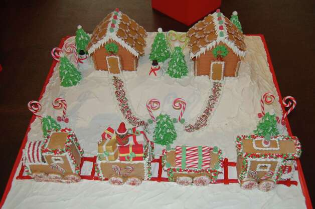 "Angela Mia Italian Pastry in Norwalk, Conn., created the Christmas Train for ""Visions of Gingerbread: The Sweetest Architects IV,"" which is on display at the Stamford Museum and Nature Center in Stamford, Conn., through Sunday, Jan. 27. It is one of 10 gingerbread creations. For more information, call 203-322-1646. Photo: Contributed Photo"