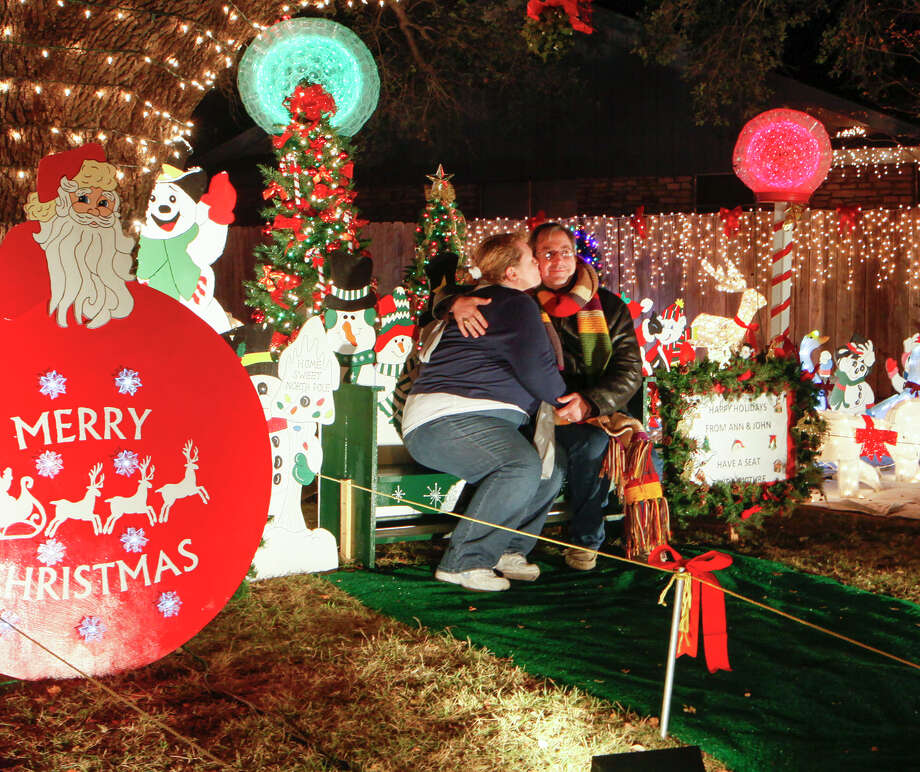 a couple poses for a photo at ann and john white home at 8629 that took - Windcrest Christmas Lights