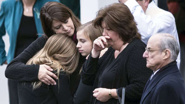 Mourners arrive for the funeral Mass of Jessica Rekos at St. Rose of Lima Roman Catholic Church December 18, 2012 in Newtown, Connecticut. Rekos, age 6, is one of the victims from last Friday's shooting at Sandy Hook Elementary School which took the lives of 20 students and 6 adults.  AFP PHOTO/Brendan SMIALOWSKIBRENDAN SMIALOWSKI/AFP/Getty Images Photo: BRENDAN SMIALOWSKI, . / 2012 Brendan Smialowski