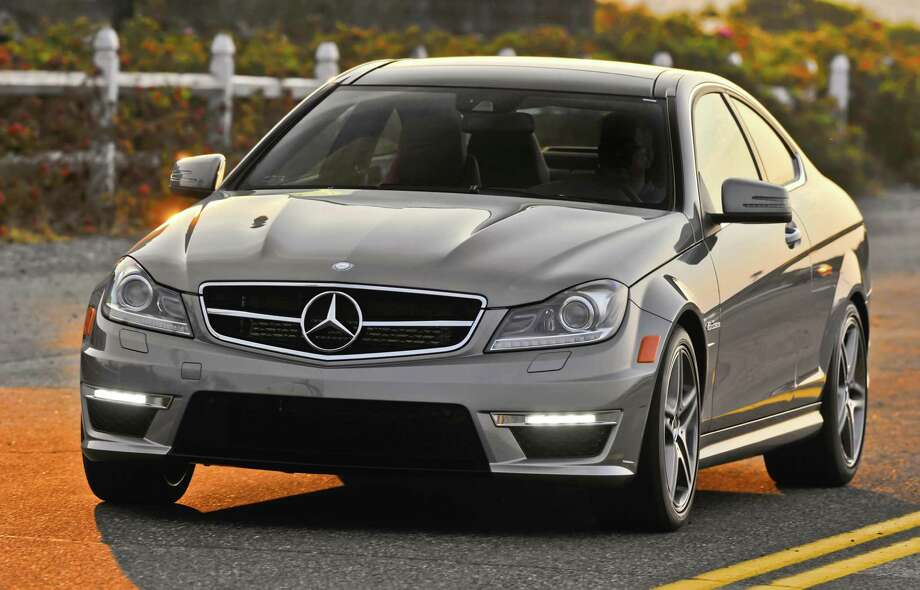 Mercedes-Benz C63 AMGLuxury CoupeMiles Per Gallon: 15Green House Gas: 3Air Pollution: 5Total: 23 Photo: Mercedes-Benz / Copyright 2011