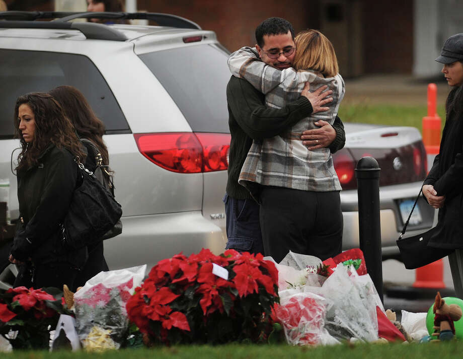 Mourners embrace outside the funeral of James R. Mattioli, one of the children killed in the Sandy Hook Elementary School shootings, at St. Rose of Lima Catholic Church in Newtown on Tuesday, December 18, 2012. Photo: Brian A. Pounds / Connecticut Post