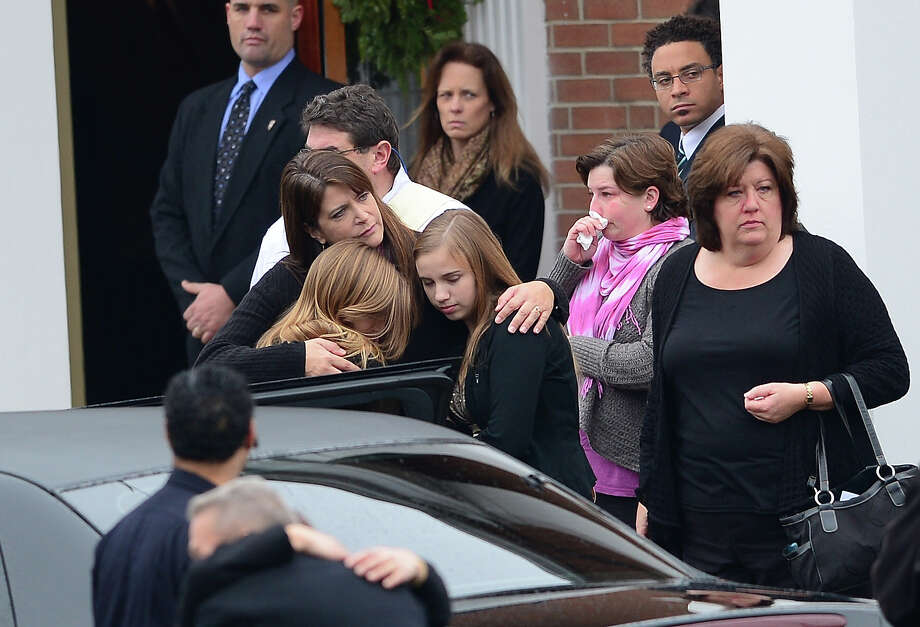 Close relatives of Jessica Rekos, 6, arrive at Saint Rose of Lima Church on December 18, 2012 in Newtown, Connecticut to attend her funeral service.  Photo: EMMANUEL DUNAND, AFP/Getty Images / 2012 AFP