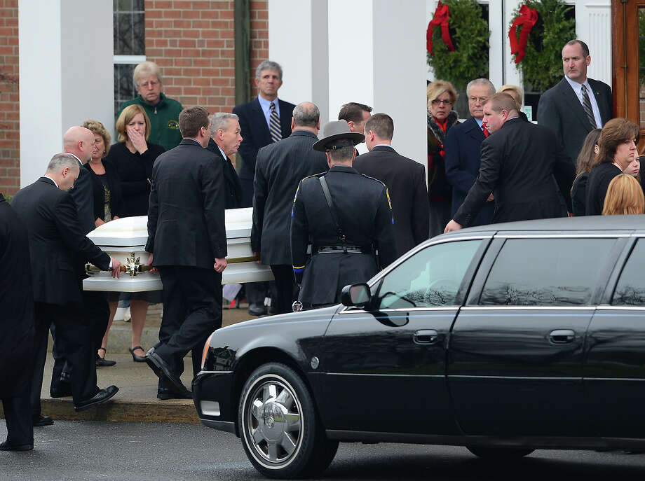 The casket of Jessica Rekos, 6, is carried into Saint Rose of Lima Church on December 18, 2012 in Newtown, Connecticut, for her funeral service. Most children in Newtown returned to classes for the first time since last week's massacre, but survivors of the shooting stayed at home and their school remained a crime scene. Photo: EMMANUEL DUNAND, AFP/Getty Images / 2012 AFP