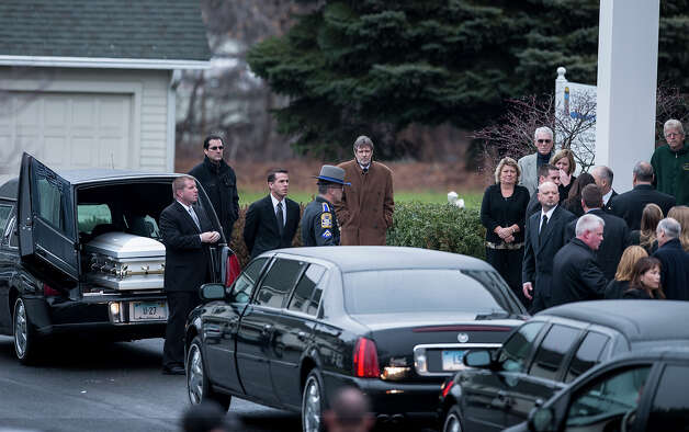 People arrive for the funeral Mass of Jessica Rekos at St. Rose of Lima Roman Catholic Church December 18, 2012 in Newtown, Connecticut. Photo: BRENDAN SMIALOWSKI, AFP/Getty Images / 2012 AFP