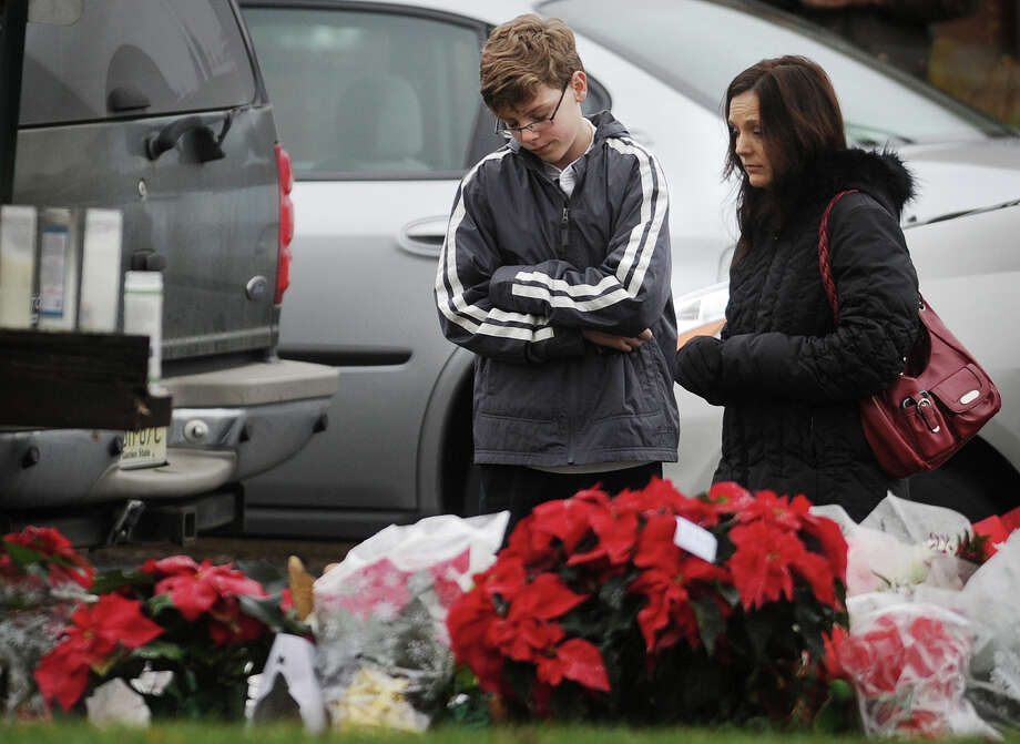 Mourners  outside the funeral of James R. Mattioli, one of the children killed in the Sandy Hook Elementary School shootings, at St. Rose of Lima Catholic Church in Newtown on Tuesday, December 18, 2012. Photo: Brian A. Pounds / Connecticut Post