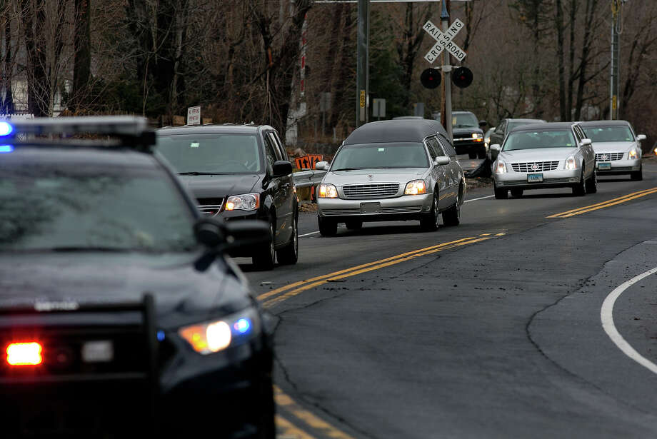 The funeral procession for James Mattioli, 6, who died in the Sandy Hook Elementary School shootings, approaches the St. John's Cemetery Tuesday, Dec. 18, 2012, in Darien, Conn. Photo: AP