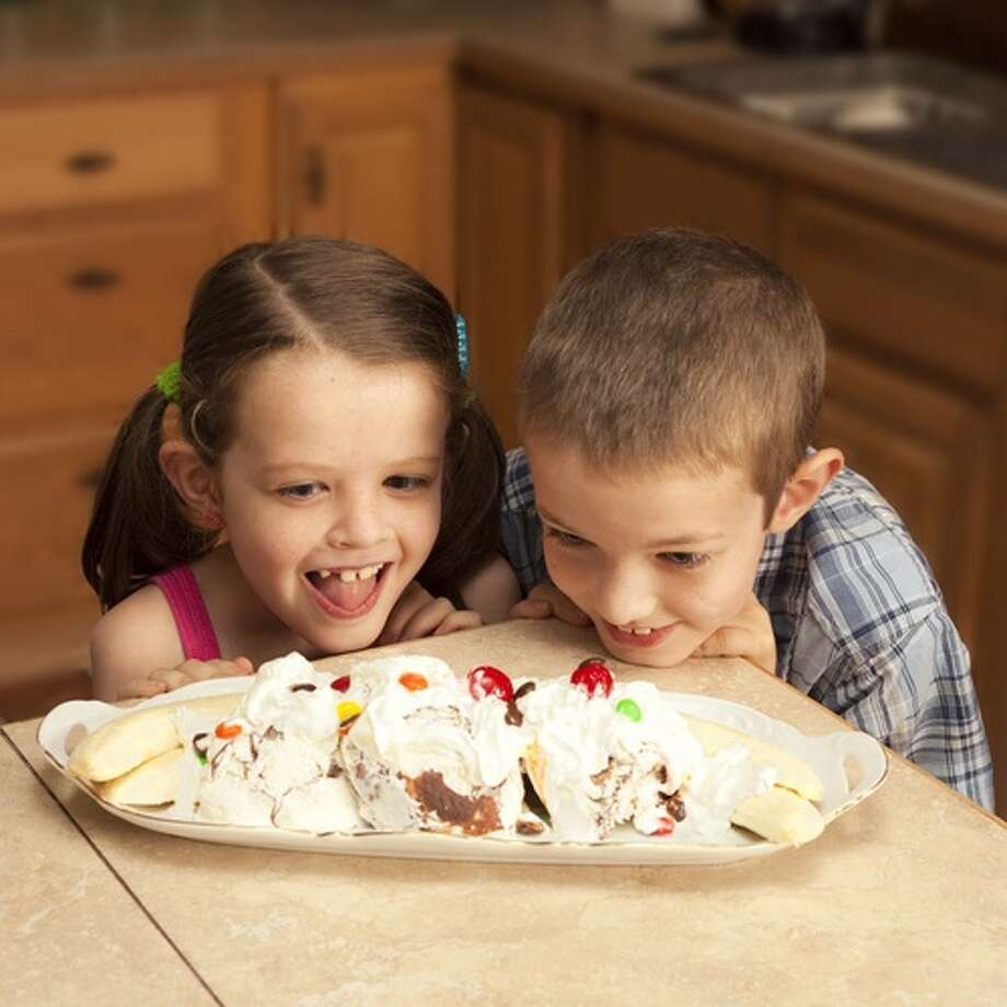 "In June more than 50,000 moms and dads spread throughout the world served banana splits to their children for dinner. The dessert extravaganza was inspired by the story of Erik and Diane Roberts, parents of a 21-month-old son with Down syndrome and a heart defect. When the the Pittsburgh couple received news that nothing more could be done for Ryan, Diane posted a message on Facebook: ""Go out and create a memory with your kid. Throw a banana split on the table for dinner. Wouldn't you remember having banana splits for dinner one night when you were a kid?"" (Shutterstock)"