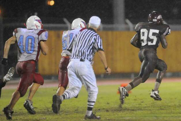 Central defensive end Kewan Alfred recovers a fumble for a 90- yard touchdown against Lumberton in the first half at Zaharias Stadium. Friday,  October 9, 2009. Valentino Mauricio/The Enterprise Photo: Valentino Mauricio / Beaumont