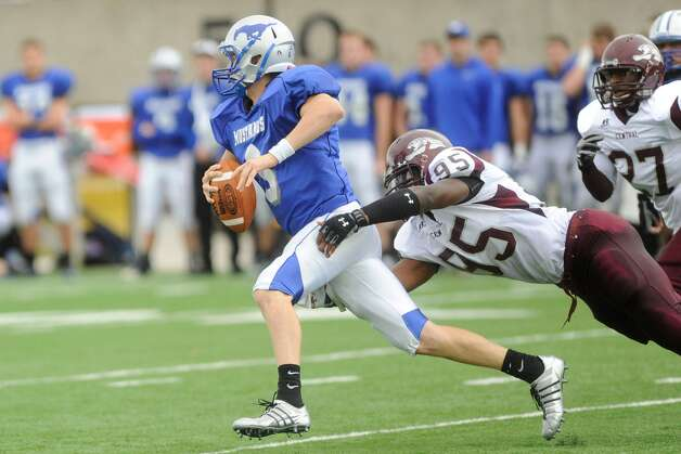 Friendswood quarterback Pete Maetzold (6) is tackled by Central's Kewan Alfred (95), in the first half of playoff action at Baytown's Stallworth Stadium. Saturday,  November 28, 2009. Valentino Mauricio/The Enterprise Photo: Valentino Mauricio / Beaumont