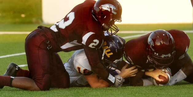 "Central's Elliot Brown and Kewan Alfred and Galveston Ball's Joergen Sjostrom scramble for a Galveston Ball's fumble at the Carrol A. ""Butch"" Thomas Educational Support Center in Beaumont, Saturday. Tammy McKinley/The Enterprise Photo: TAMMY MCKINLEY / Beaumont"