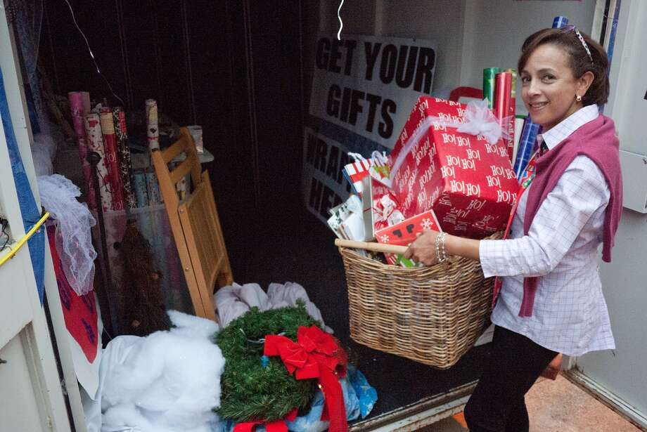 """Marie Simien and her sister AndrŽa Ehlers (not shown) run """"Wrap It Up!,"""" a mobile giftwrapping service.  Photo by R. Clayton McKee Photo: R. Clayton McKee, Freelance / © R. Clayton McKee"""