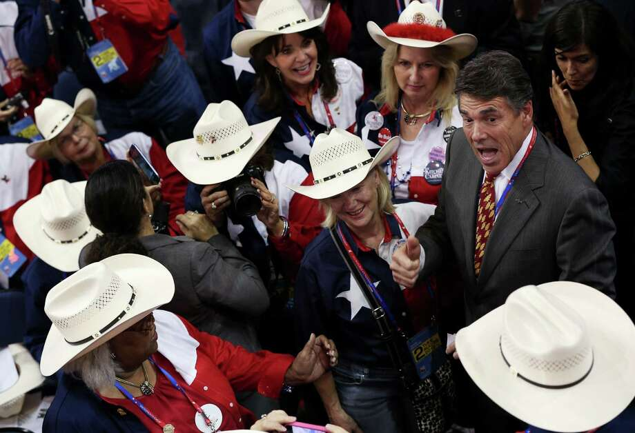 Texas Gov. Rick Perry (R) greets the delegation fron Texas during the Republican National Convention at the Tampa Bay Times Forum on August 28, 2012 in Tampa, Florida. Today is the first full session of the RNC after the start was delayed due to Tropical Storm Isaac. Photo: Win McNamee, Getty Images / 2012 Getty Images