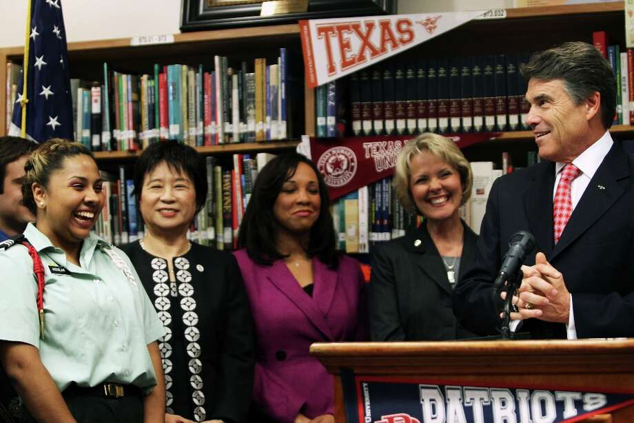 Texas Gov. Rick Perry addresses Janahy Aguilar (far left), a trilingual college-bound student at Thomas Jefferson High School in Dallas, Texas where he announced plans to make higher education more affordable and accessible for students, Monday, Oct. 1, 2012. Perry plans to freeze college tuition for four years and will use outcome-based funding for high schools. (AP Photo/The Dallas Morning News, Katie Currid) Photo: Katie Currid, Associated Press / The Dallas Morning News